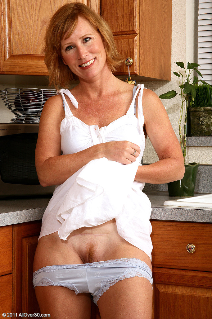 redheaded milf in kitchen