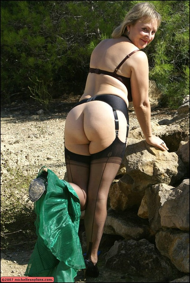 Mature in stockings outdoors