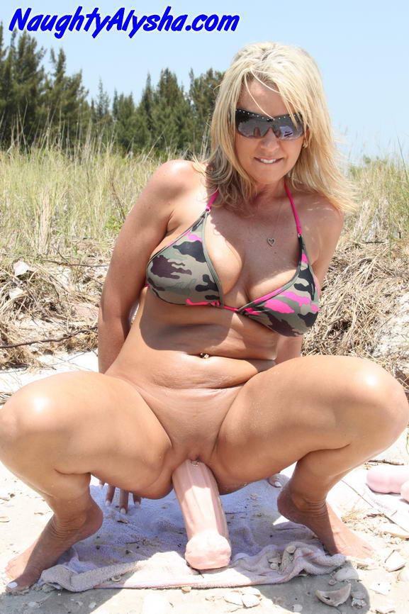Bikini busty beach milf