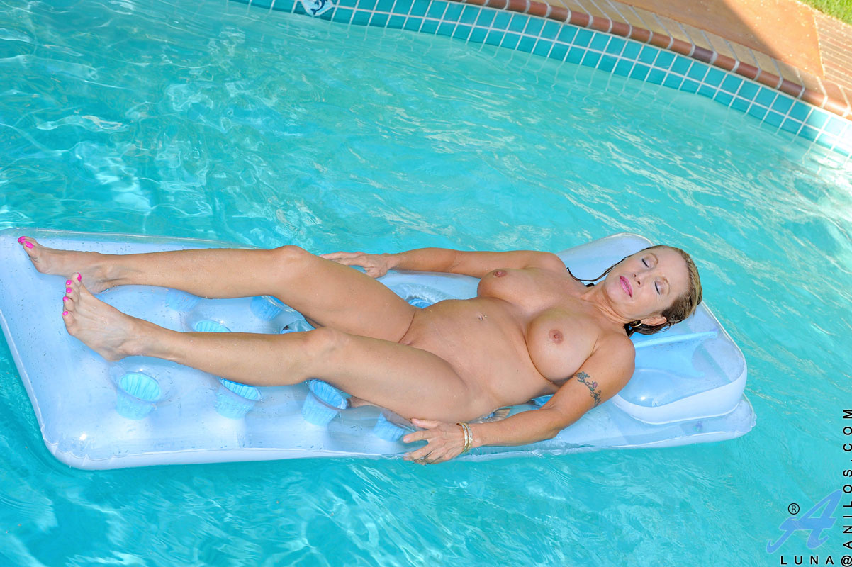 Nude milf swimming