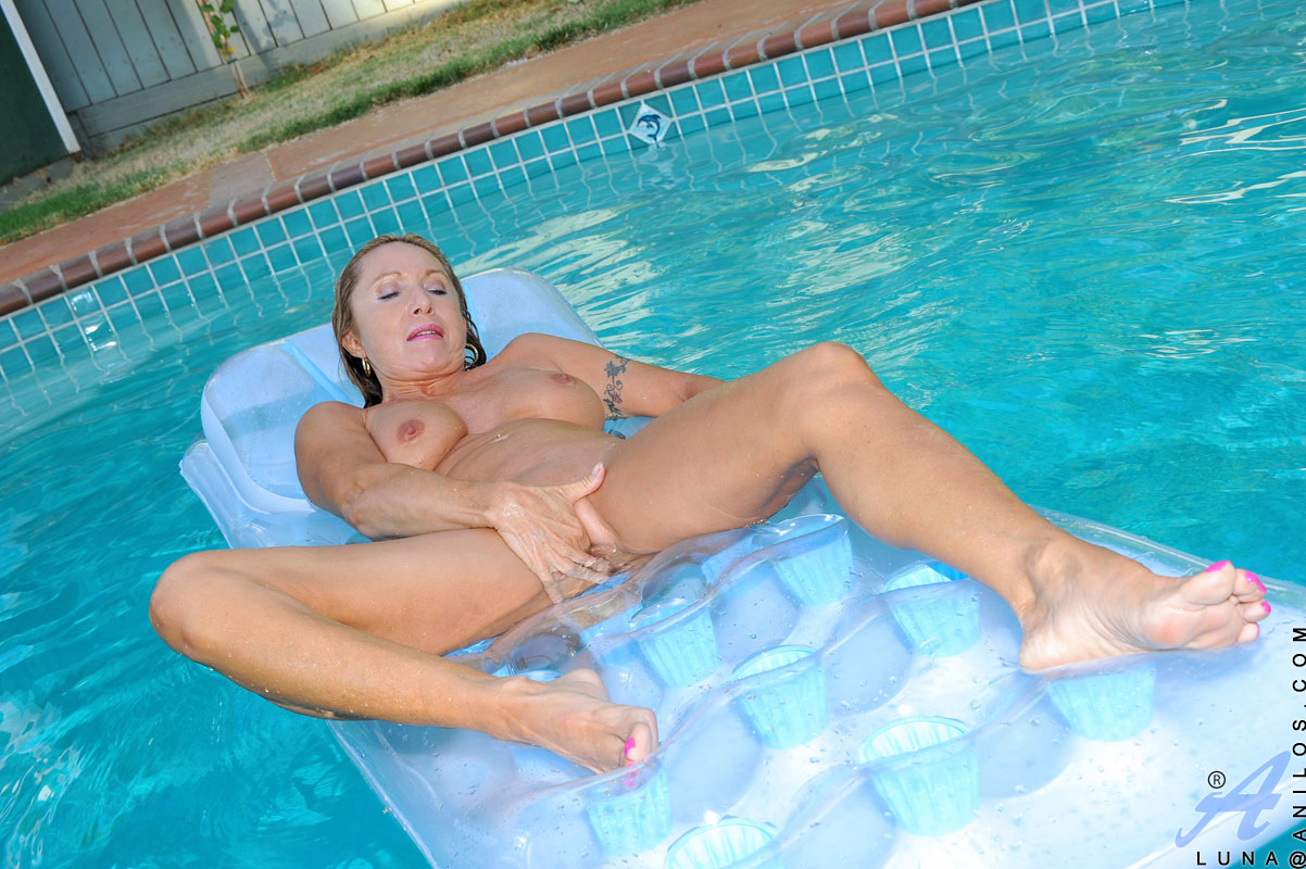 Mature nude women swimming pool