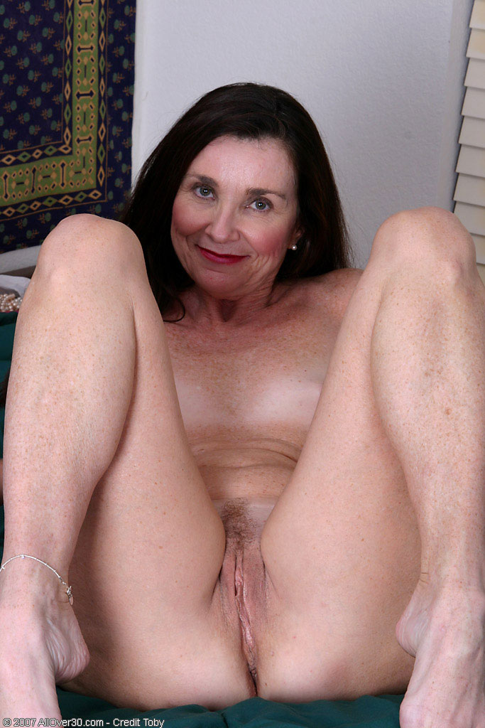 Mature woman licks own pussy