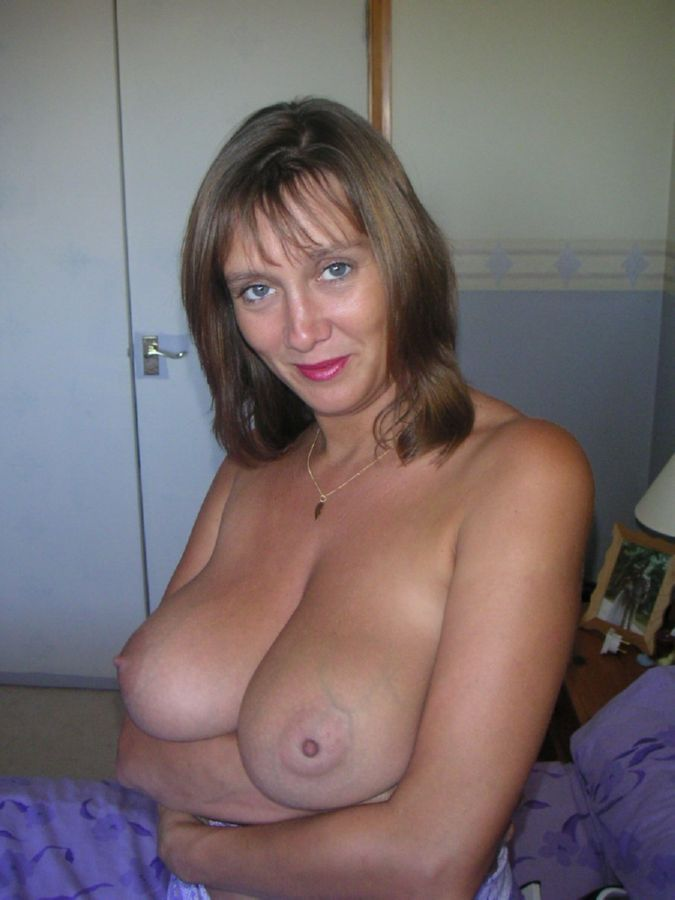 Solo milf strips out of her lingerie and stockings and fingers her pussy 2