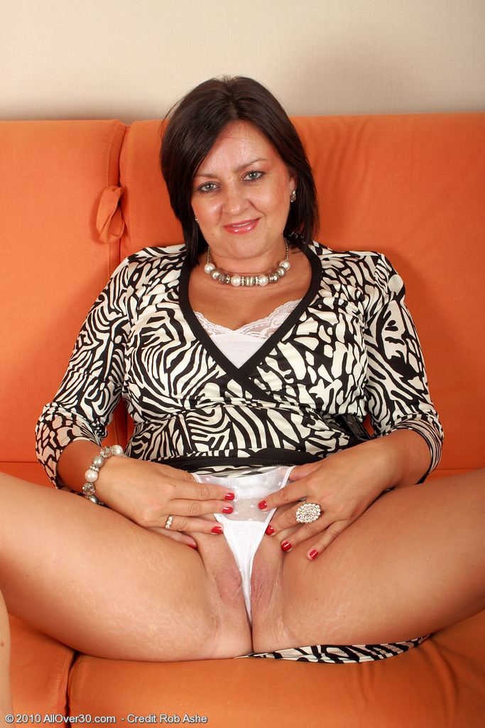 Chubby mother takes her white lingerie off and pinches on her puffy pussy ...