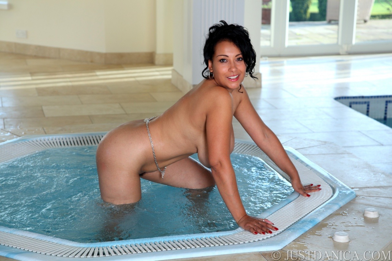 women in jacuzzi naked