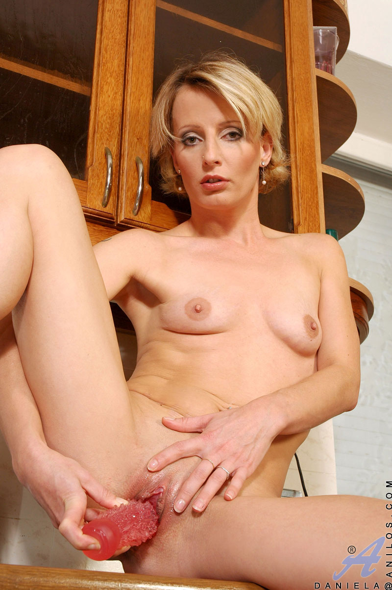 Mature using sex toys from it